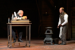 "Ebenezer Scrooge (Richard Farrell) scolds his clerk Bob Cratchit (Ric Iverson) in ""A Christmas Carol."" (Photo by Kevin Berne)"