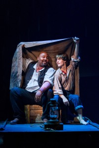 "Jim (James Monroe Iglehart) and Huck (Alex Goley) escape down the Mississippi River in Theatreworks Silicon Valley's production of ""Big River,"" through Dec. 30th. (Photo by Mark Kitaoka)"