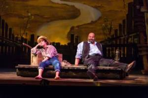 "Huck (Alex Goley) and Jim (James Monroe Iglehart) escape down the Mississippi in TheatreWorks' production of ""Big River"" in Palo Alto (Photo by Mark Kitaoka)"