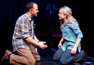 "Dan (Joe Cassidy) stands by his wife Diana (Kendra Kassebaum) in San Jose Repertory Theatre's production of ""Next to Normal."" (Photo by Tim Fuller/Arizona Theatre Company)"
