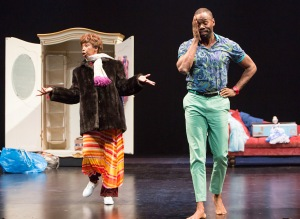 "Aunt Glo (Sharon Washington) cleans out the closet of her deceased sister Adelaide, much to the chagrin of Adelaide's son Gil (Colman Domingo) in the TheatreWorks Silicon Valley production of ""Wild With Happy."" (Photo by Mark Kitaoka)"