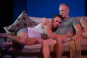 "Luke (Adam Shonkwiler, left) and Adam (Danny Scheie share a tender moment in ""Next Fall,"" playing through Nov. 10th in San Jose. (Photo by Kevin Berne)"