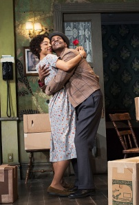 "Ruth Younger (Sophie Okonedo) and husband Walter Lee (Denzel Washington) share a moment of warmth in Broadway's ""A Raisin in the Sun."" (Photo by Bridgette Lacombe)"