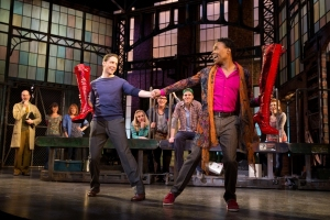 "Charlie (Andy Kelso) and Lola (Billy Porter) join forces to breathe life in a small town factory in ""Kinky Boots."" (Photo by Matthew Murphy)"