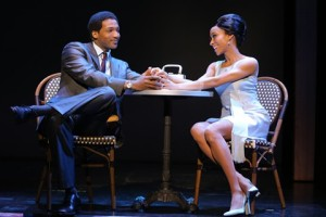 """Berry Gordy, Jr. (Clifton Oliver) and Diana Ross (Allison Semmes) discuss ways to keep their personal and professional relationships separate in """"Motown: The Musical,"""" playing through Sept. 28th in San Francisco's Orpheum Theatre. (Photo by Joan Marcus)"""