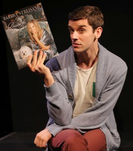 "Alex More (Michael Urie) takes a job in a fictitious mall owned by legend Barbra Streisand in ""Buyer and Cellar"" that runs at the Curran Theatre in San Francisco through Sunday, Aug. 31st. (Photo by Joan Marcus)"