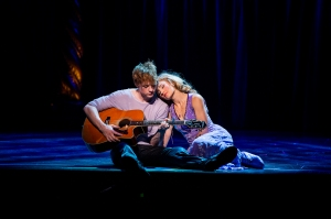 Pippin (Thomas) finds his love song and sings it to Catherine (Kristina Reese) (Photo by Terry Shapiro)