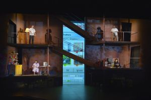 """Erik Flatmo's multiple-leveled set allows for the many storylines to move through the space in """"Water by the Spoonful."""" (Photo by Kevin Berne)"""