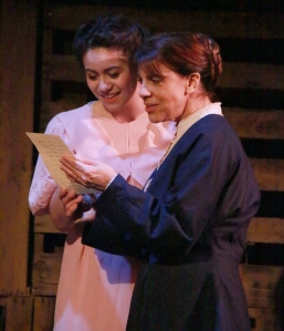 Clara Krieger (Ivette Deltoro) and Frau Krieger (Mary Lou Torre) excitedly read a letter from the battlefield. (Photo by Mike Ko)