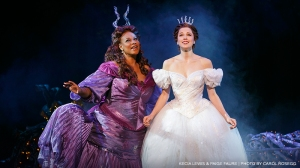 The Fairy Godmother (Kecia Lewis) prepares Cinderella (Paige Faure) for the Ball. (Photo by Carol Rosegg)