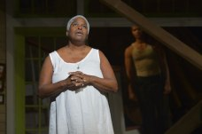 "Shelah (Cheryl Lynn Bruce) deals with the pain of loss as the Angel (Sullivan Jones)  looks on in ""Head of Passes"" at Berkeley Rep. (Photo by kevinberne.com)"