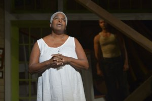Shelah (Cheryl Lynn Bruce) deals with the pain of loss as the Angel (Sullivan Jones)  looks on in