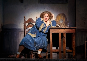 "Ms. Hannigan (Lynn Andrews) basks in the anger of being surrounded by ""Little Girls."" (Photo by Joan Marcus)"
