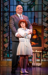 Oliver Warbucks (Gilgamesh Taggett) and Annie (Swickle) form a strong bond. (Photo by Joan Marcus)