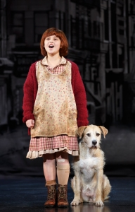 """Annie (Issie Swickle) and her dog Sandy (Sunny) take on Depression era New York CIty in """"Annie,"""" at the Golden Gate Theatre. (Photo by Joan Marcus)"""