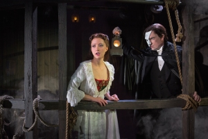 The Phantom (Chris Mann) takes Christine (Katie Travis) to his underground lair in