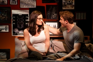Elizabeth (Idina Menzel) and Joshua (James Snyder) share an intimate moment in
